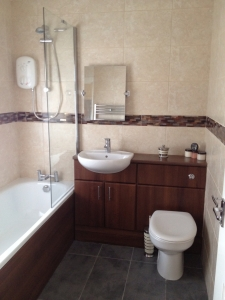 Full bathroom installation inclusive of wall and floor tiling, electrical shower and bathroom suite.